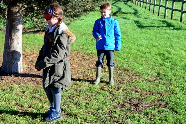 forest school child directing blindfolded partner