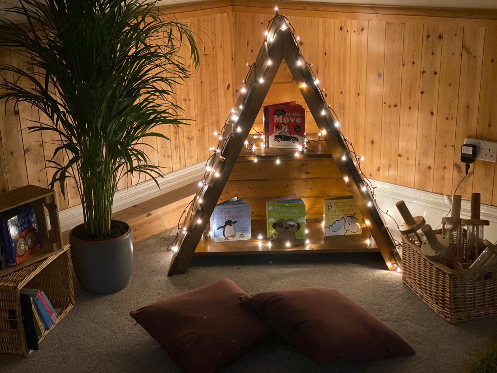 Enabling environment featuring an enchanted house with fairy lights and books