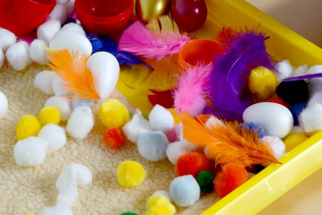 pop pom and feathers tray close up