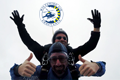 Staff jump for joy after completing charity skydive